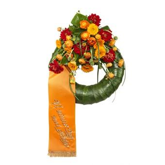 Trauerkranz mit orangefarbener Schleife