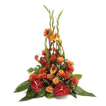 Trauergesteck in rot und orange